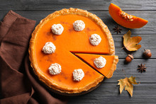 Fresh Delicious Homemade Pumpkin Pie With Whipped Cream On Wooden Background, Flat Lay