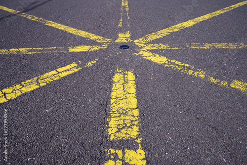 Fotografie, Obraz  yellow star shaped road marking for backgrounds