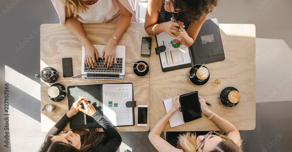 Fototapety, obrazy: Group of women working together in coffee shop