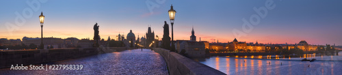 Leinwand Poster Panoramic image of Charles bridge and Vltava river at dawn