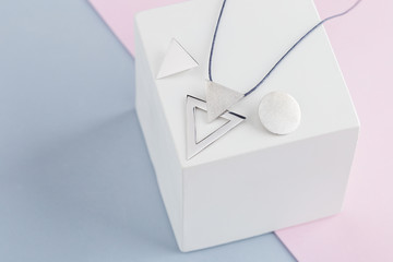 Jewelry kit of silver triangles and circles for geometric necklace