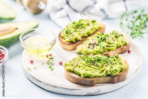 Valokuva  Smashed avocado sea salt and herbs toast