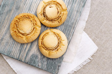Delicate Crispy Cookies In Form Of Mushrooms. Baked Sweet Biscuits On Wood Board With Copy Space. Top View.