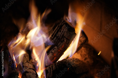 Flames on wood in fireplace