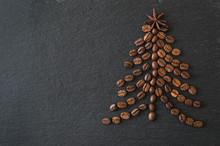 Christmas Tree Lined From Coffee Beans On A Dark Background