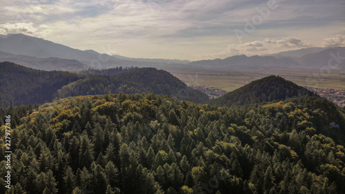 Foto op Plexiglas Grijze traf. Aerial view of beautiful Transylvania. Carpathian mountains in autumn, sunset with beautiful collors and clouds.