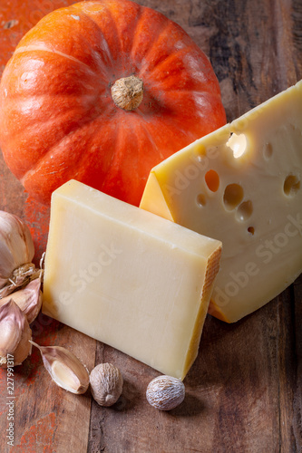 Ingrediens for traditional seasonal Swiss dish, pumpkin fondue with gruyer and emmentaler cheeses, fresh creme and nutmeg