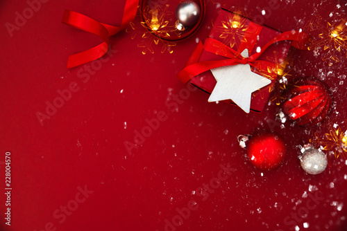 Christmas and New Year holiday background. Xmas greeting card. Christmas gifts on red background top view.