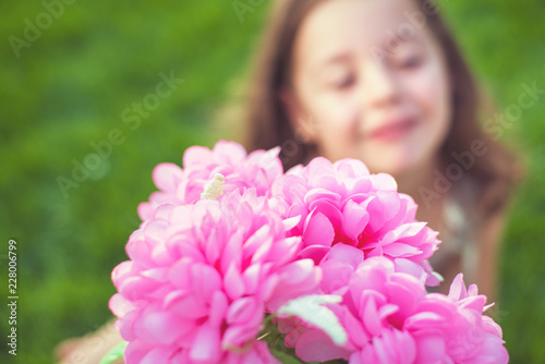 Foto op Canvas Artist KB Pretty little girl holding colorful flowers