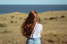 Long Hair Girl On A Nature Background.
