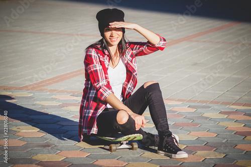 Fotografie, Obraz  Beautiful woman with a skateboard on the street