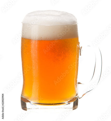 Cold mug of light beer with foam isolated on white background.