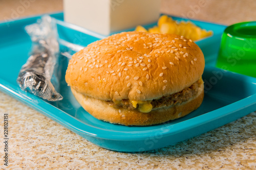 Tuinposter Assortiment School Lunch Tray Cheeseburger