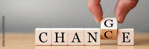 Photographie  Hand flip wooden cube with word change to chance, Personal development and c