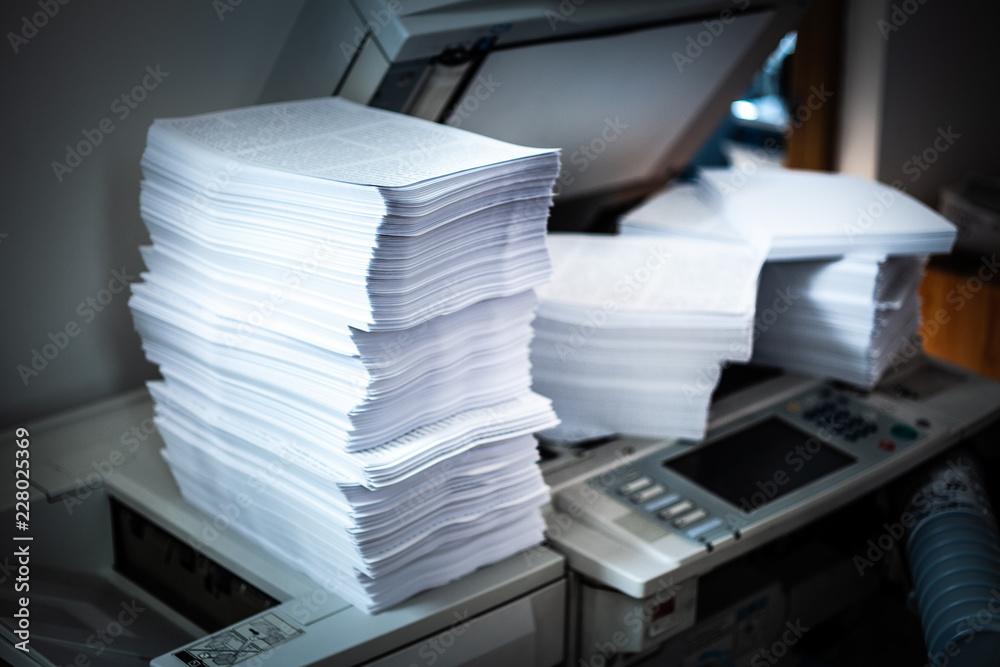 Fototapeta Pile of printed papers