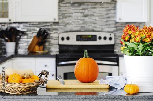 Autumn pumpkin on the kitchen table