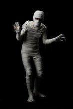 Studio Shot Portrait  Of Young Man In Costume  Dressed As A Halloween  Cosplay Of Scary Mummy Pose Like A Clamber Acting On Isolated Black Background.