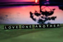 Love One Another On Wooden Blo...