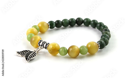 Obraz na płótnie Colorful gemstone bracelet with silver leaves isolated on white background