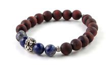 Unpolished Red Tiger's Eye Stone Bracelet With Sodalite Gemstone And Silver Owl Figurine Isolated On White Background
