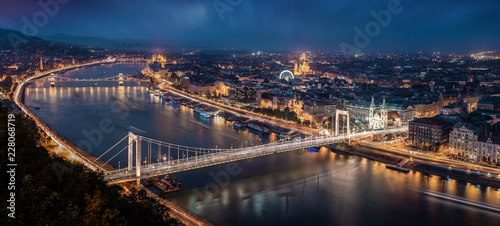 Budapest, Hungary - Aerial panoramic skyline of Budapest at blue hour. This view includes Elisabeth Bridge (Erzsebet Hid), Szechenyi Chain Bridge, Parliament and St. Stephen's Basilica