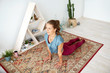 fitness, sport and healthy lifestyle concept - woman doing yoga upward-facing dog pose on mat at studio