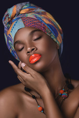 Fototapeta Do Spa African woman with a colorful shawl on her head