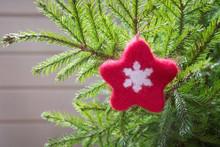Christmas Tree With Handmade Red Felt Star As Decor. Xmas Card. Close Up. Copy Space. Xmas.