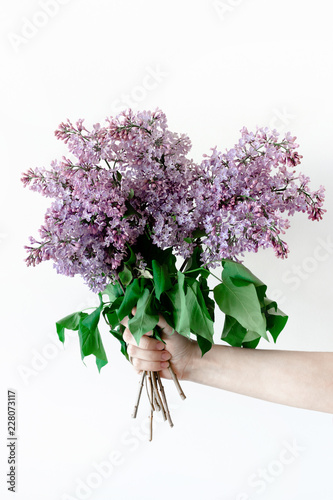 Girl hold in hands bouquet of lilac flowers