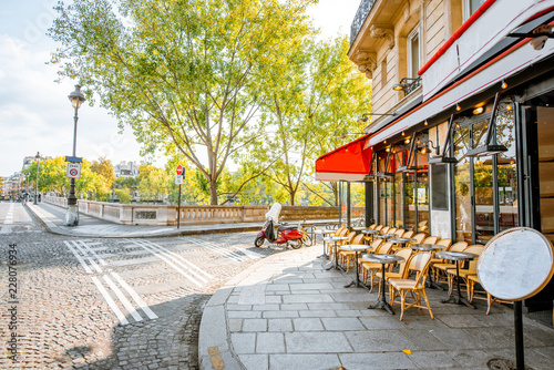 Fotomural Street view with beautiful buildings and cafe terrace during the morning light i