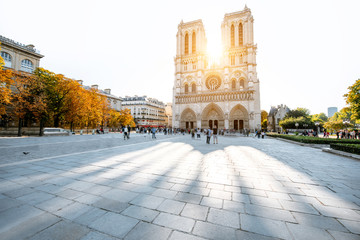 View on the famous Notre-Dame cathedral and square during the morning light in Paris, France