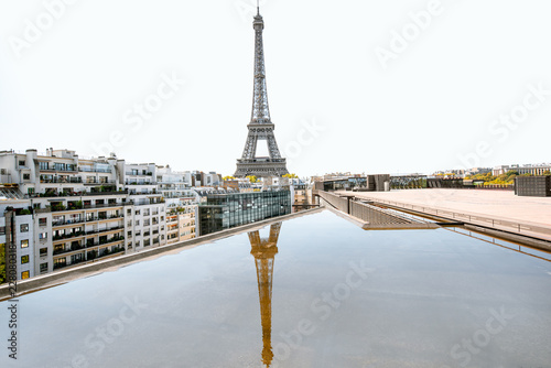 Poster Tour Eiffel Beautiful cityscape view on Eiffel tower with reflection in the water during the daylight in Paris