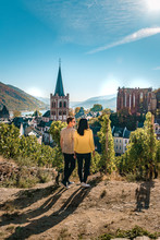 Bacharach Germany Middle Rhine Valley, Young Couple Looking Out Over The Village From The Hill At The Wine Field