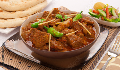 Chicken Kerhai, Delicious Chicken cooked in traditional wok pan with lot of chillies and spices.