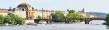 Prague, Czech Republic, Panoramic View From Charles Bridge. Vltava River, Legion Bridge, National Theater, Slavonic Island, Boat Stations, Relax Locals And Tourists