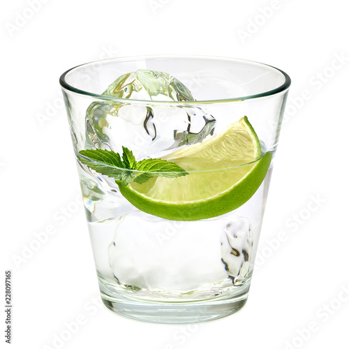 Fotografija Vodka lime, gin tonic, mojito or Caipirinha cocktail with lime wedge isolated on