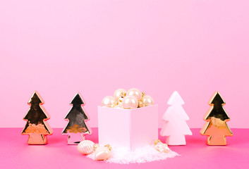 Christmas tree balls on a pink background.