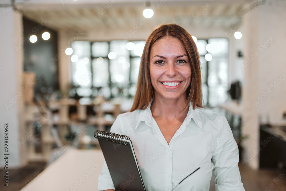Fototapeta Headshot of young smiling businesswoman. Looking at camera.