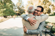 canvas print picture - Family reunion. Father and son hugging outdoors.