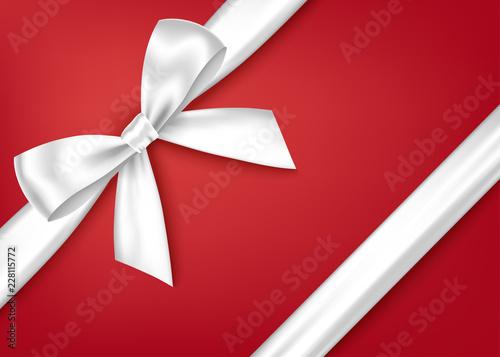 Obraz White  decorative  gift ribbon and bow for decor of corner. - fototapety do salonu