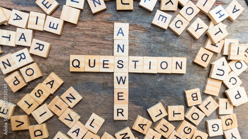 Photo Question answer text on wood squaer block