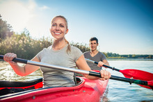 Smiling Young Woman Kayaking W...