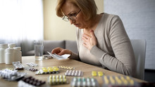 Senior Lady Feeling Unwell, Poor Quality Of Medication Dangerous Self-medication