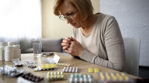 Valokuvatapetti Woman reading prescription, side effect of medication, old age disease addiction
