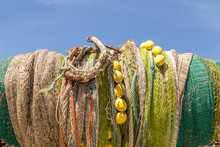 Many Fishing Nets Laid Outdoor, Drying In The Sun. Traditional Craft Of Spain Mallorca, Spain, Western Europe.