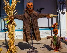 Two Halloween Scarecrows On Street