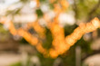 canvas print picture Bokeh shot at night of outdoor restaurant at night. At restaurant blur background with bokeh.