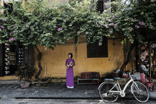 Woman With Bouquet Standing On Pavement, Hoi An, Vietnam