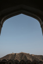 Low Angle Mid Distance View Of Fort On Mountain Against Clear Sky Seen Through Doorway