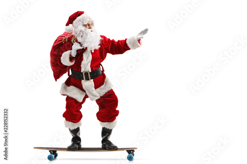 Photo  Santa Claus riding a longboard isolated